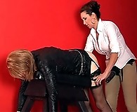 Strapon Jane bends over a TGirl on her fuck bench and punishes her