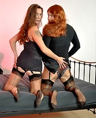 This redheaded TGirl gets really horny when she feels Janes monster strapon.