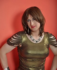 This TGirl looks gorgeous in her golden dress and she is looking to get filthy.