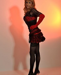 Gorgeous blonde crossdresser wearing a sexy basque and nylon stockings.