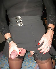 Crossdressers spreading their legs wide open and showing off their big dicks.