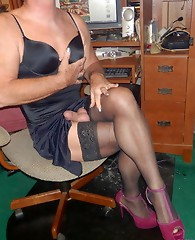 Crossdressers in gorgeous outfits showing their hard cocks and long legs.