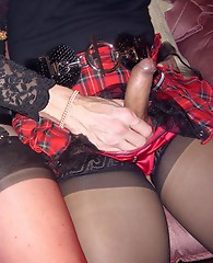 Horny crossdresser sluts show off their hard cocks in their panties.