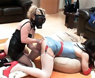 Kirsty gets a huge dildo pushed into her ass and then gets fucked hard with a strapon.