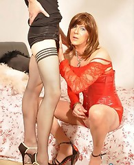 TGirl sluts take turns sucking each others hard cocks until one of them shoots her load.