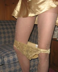 Gold panties, sparkling stockings and a sexy cock make this sissy pantie boy look like a real star