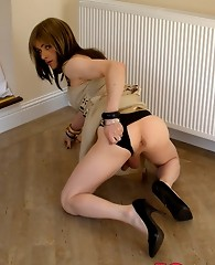 Gorgeous Tgirl Kirsty slowly removing her clothes