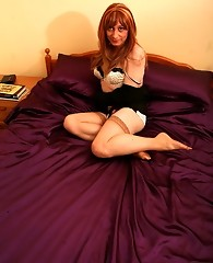 Lucimay laying on purple bed takes huge cock in her mouth