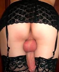 Crossdresser wearing black nylon stockings and lingerie
