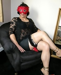 Masked crossdresser gets her hard cock teased and sucks feet