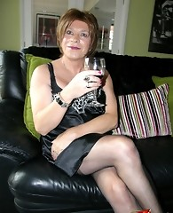 Sexy tranny slut sipping on wine and posing