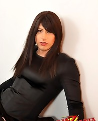 Gorgeous crossdresser with long black hair posing