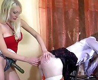 Wearing a blouse and a skirt sissy getting his ass filled with a strap-on